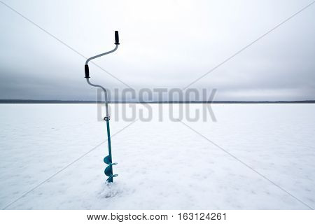 borer for winter fishing on a frozen lake