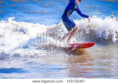 surfer dude on a surfboard riding ocean wave