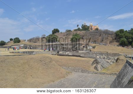 Church and Ruins. Our Lady of the Remedies church stands on the top of what looks like an ordinary hill but is really the Great pyramid of Cholula, Puebla Mexico