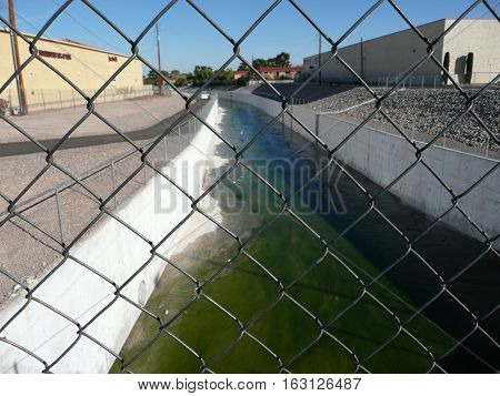 n-us-nv  Las Vegas, Nevada - 2007-11-15:  Canal Behind a Fence