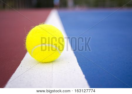 The tennis balls on the tennis court.
