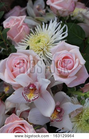 Pink roses and Cymbidium orchids wedding arrangement