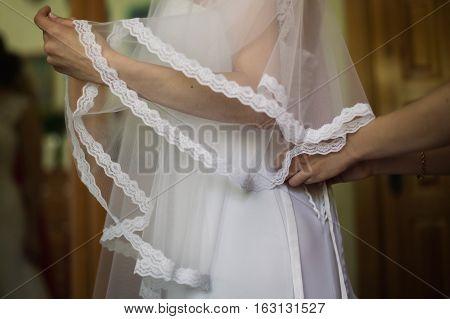 tighten wedding dress on bride, holiday morning bride