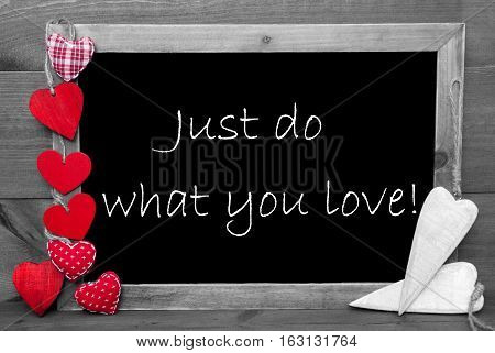 Chalkboard With English Quote Just Do What You Love. Wooden Background With Vintage, Rustic Or Retro Style. Black And White Image With Colored Hot Spots.