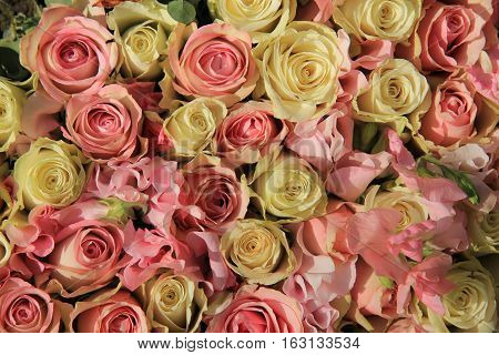 White and pink roses in floral bridal centerpiece