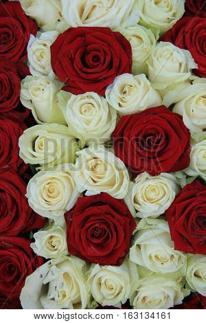 Red and white roses in a bridal floral arrangement