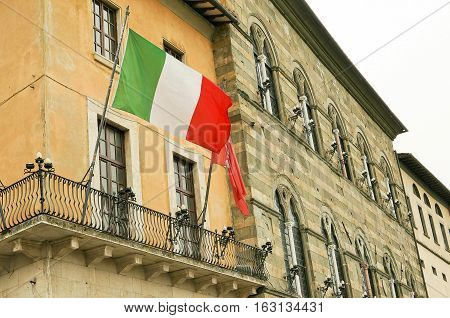PISA TOSCANY ITALY - MAY 22 2014- facade of building with italan flag
