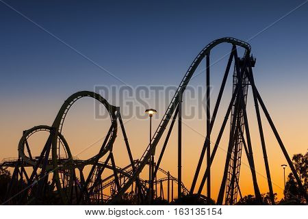 Roller Coaster Silhouette at Sunset with loops