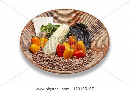 Mexican food ingredients in south western style basket isolated on white background.