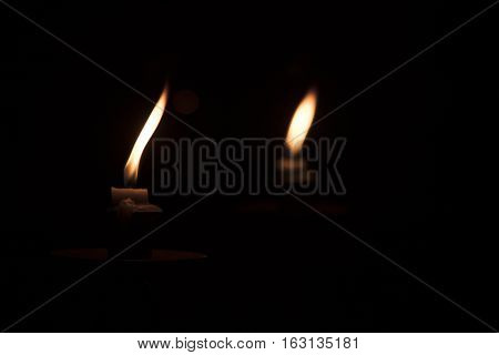 Image of flickering candlelight reflecting in a mirror