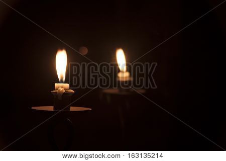 Image of candlelight reflecting in a mirror