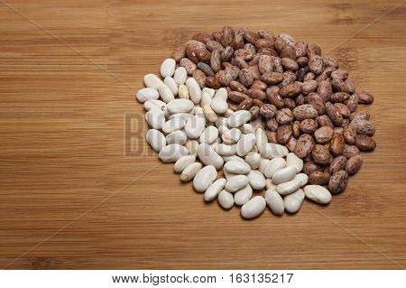 Navy and Pinto Beans on wooden cutting board