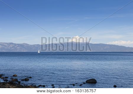 Lake Tahoe California with sail boat on the water.