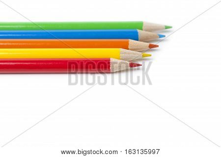 5 Colored Pencils isolated on white background.