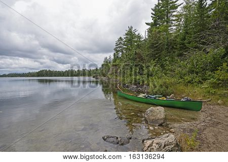 Canoe Ready to Head out to the Wilds on Meadows Lake in Quetico Provincial park in Ontario