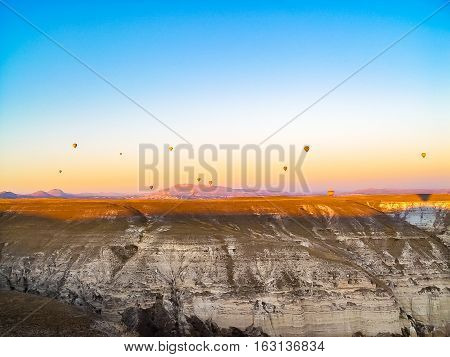 Colorful Hot Air Balloons Flying Over The Valley At Cappadocia