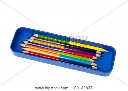 Colorful crayon color pencil in blue box