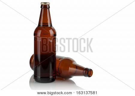 empty and full beer bottles on a white background.