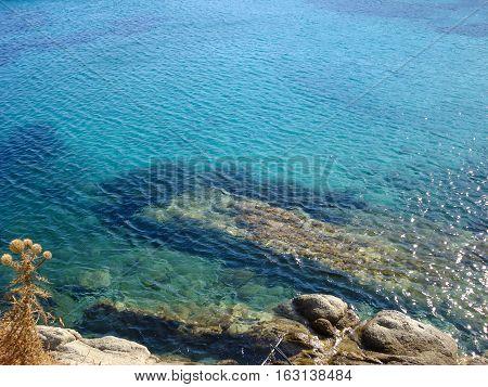 Beach In Mykonos Under  The Blue Sky