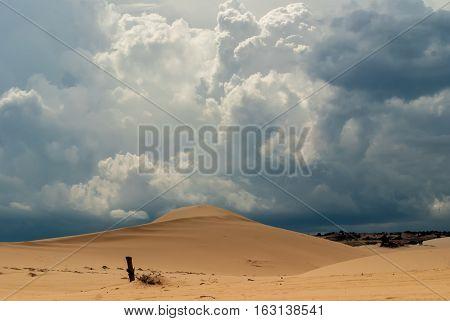 Dunes and white blue cumulus clouds Vietnam