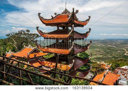 Buddhist temple on green mountain Vietnam TaCu