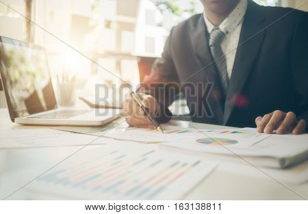 businessman working plan the business and analysis many chart graph. Film effected photo.