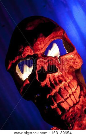 red skull with fire in eyes and blue background
