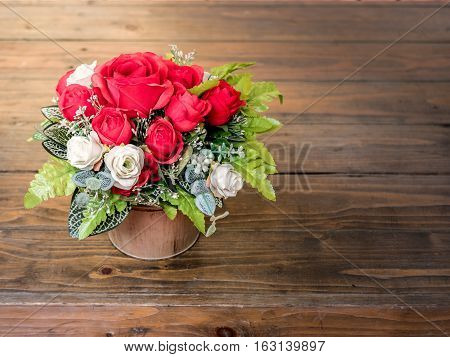 Rose Artificial Flowers In The Pot , On The Wood Desk, In The Garden