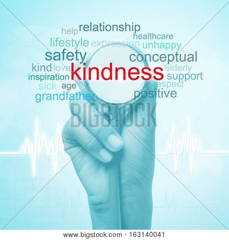hand holding stethoscope with kindness word. medical concept