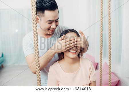 Portrait of young asian couple relaxing at home