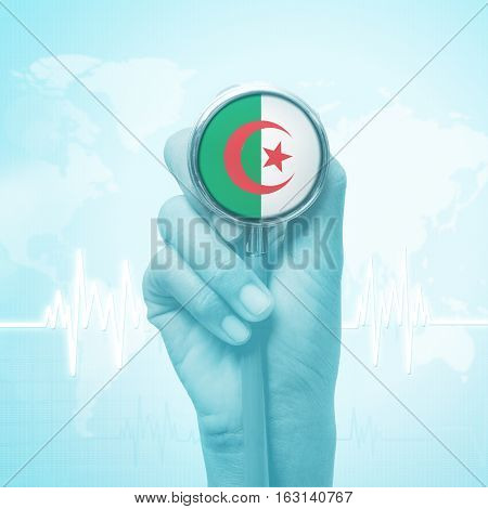 hand of doctor  holding stethoscope with Algeria flag.