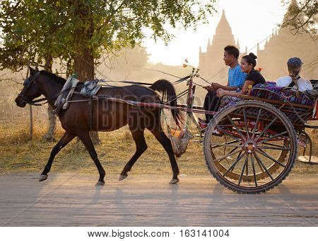 Horse Cart On Dusty Road In Bagan