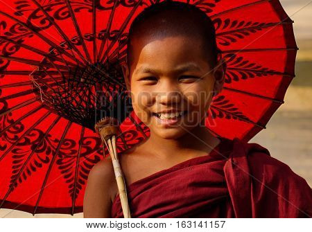 Little Burmese Monk With Umbrella