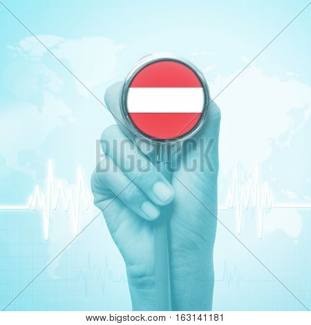 hand of doctor  holding stethoscope with Austria flag.