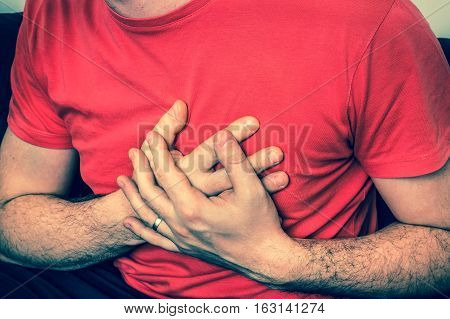 Man On Sofa Having Chest Pain, Heart Attack