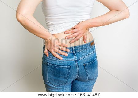 Woman With Back Pain Holding Her Aching Back