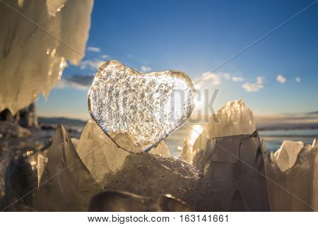 Icy Heart In The Hummock In The Light Of Sunset. Lake Baikal