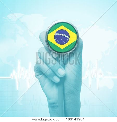 hand of doctor holding stethoscope with Brazil flag.