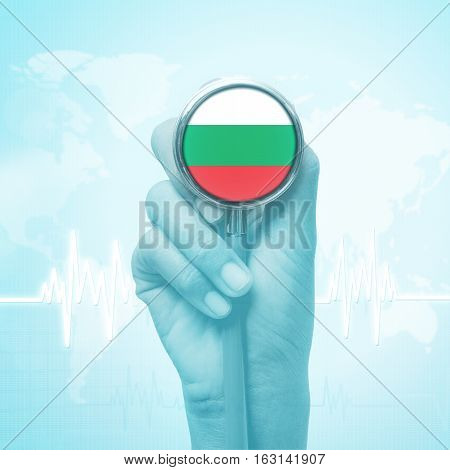 hand of doctor holding stethoscope with Bulgaria flag .