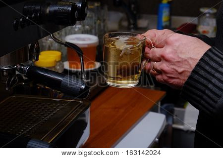 the bartender prepares tea from a tea bag