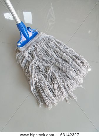 Close-up to cleaning the floor with mop