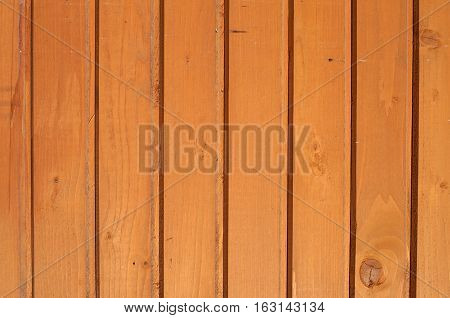 Wall made of smooth brown wooden planks, varnished