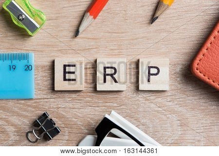 ERP abbreviation made of wooden cubes and office stationary