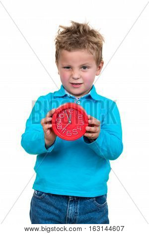 Boy is holding big clock, isolated over white.