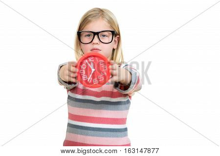 Cute girl wearing glasses with clock isolated over white.
