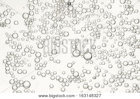 Many small air bubbles flows in a glass of water