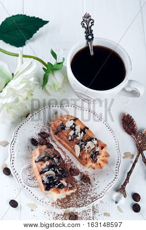 Tasty Eclairs On Table