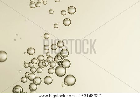 Golden bubbles soars over a gradient background