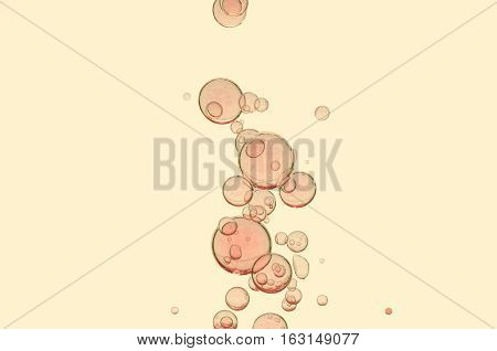 Air bubbles flows over a light yellow background