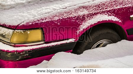 Pink car, fender of old pink car, bright pink old car in snow, old-fashioned car, pink oldtimer